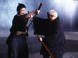 Hattori (Tadanobu Asano) & Zatoichi (Takeshi Kitano) engage in battle.
